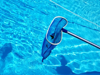 Cleaning swimming pool blue skimmer before closing