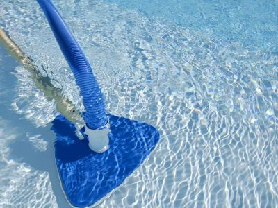 pool-cleaning-in-operation-in-a-swimming-pool-182867263-86112f17fb864031a1c7e4c9c0ec56f5
